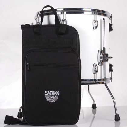 Closed premium stick bag standing beside drum