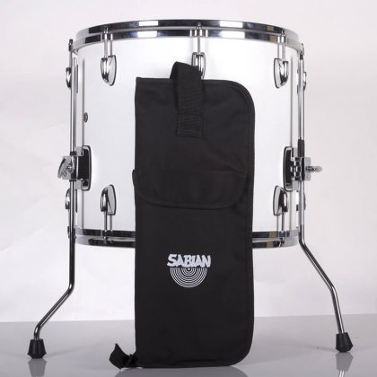 Economy stick bag standing up in front of a drum