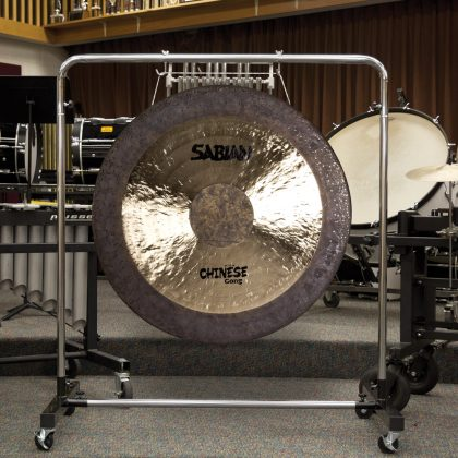 Large gong stand with wheels, displayed with a SABIAN gong