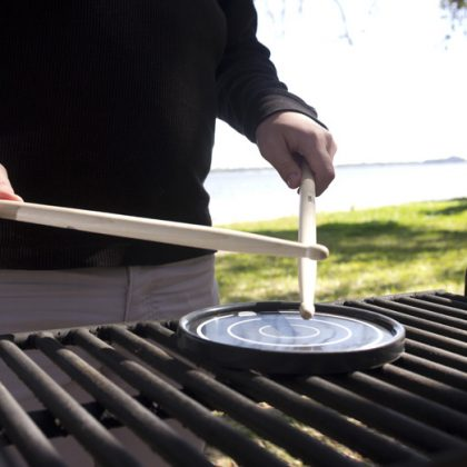 Grip disc being played on grill