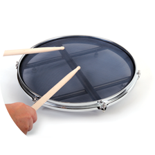 Playing Quiet Tone Mesh Practice Pad on flat surface