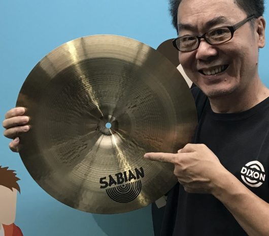 Hil Kuo playing cymbals