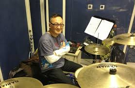 Quincy Chen playing cymbals
