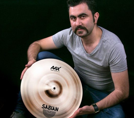 Ali Ghasemi playing cymbals