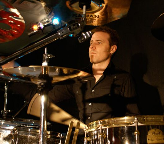 Andrew Lamarche playing cymbals