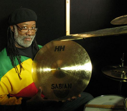 "Carlton ""Santa"" Davis playing cymbals"