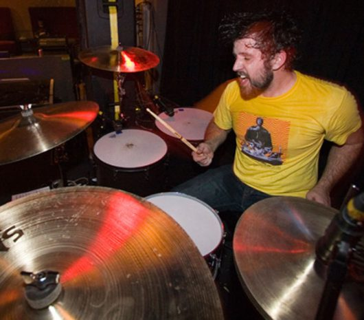 Chris Raines playing cymbals