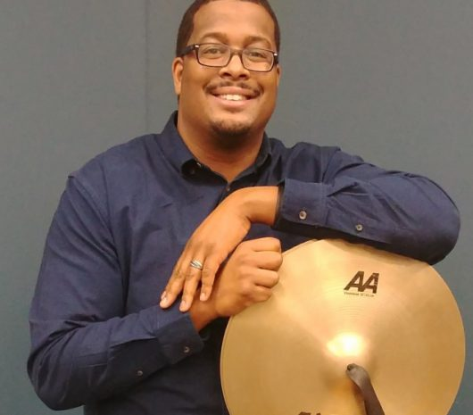 Christopher Exum playing cymbals