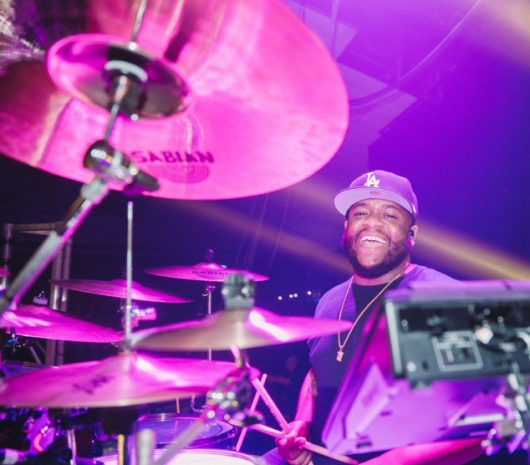Clemons Poindexter IV playing cymbals