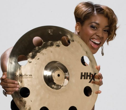 Queen Cora Coleman playing cymbals