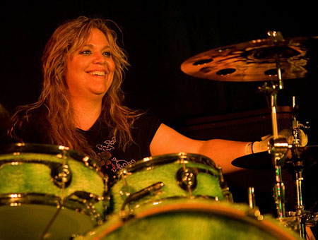 Cortney DeAugustine playing cymbals