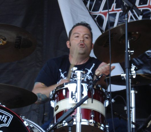 Danny  Thompson playing cymbals