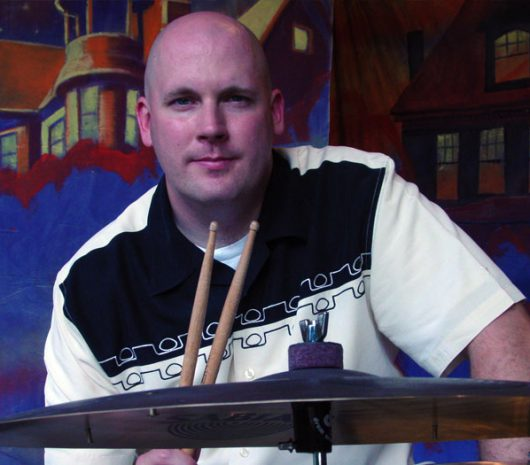 David Glover playing cymbals