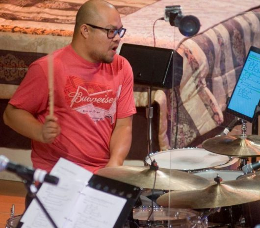 David Vuong playing cymbals