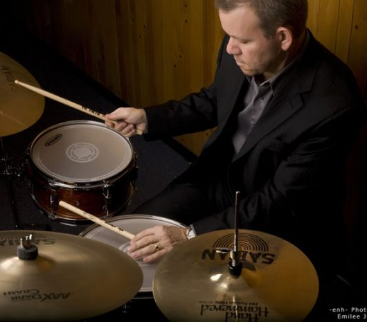 Dr. Michael Sekelsky playing cymbals
