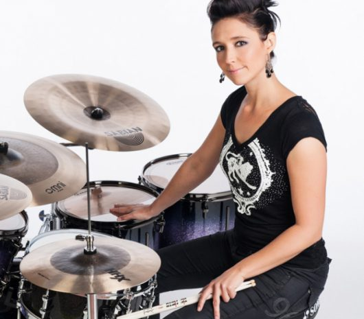 Emmanuelle Caplette playing cymbals
