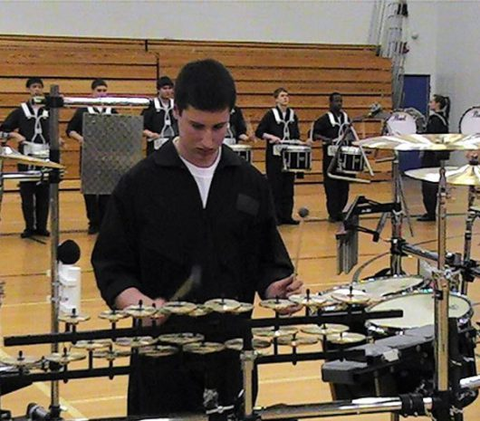Evolution Indoor Percussion playing cymbals