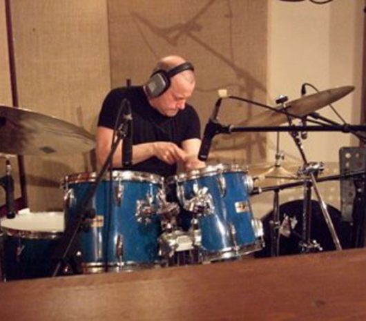Geoff Dunn playing cymbals