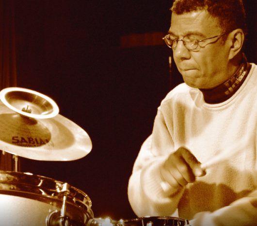 Jack DeJohnette playing cymbals
