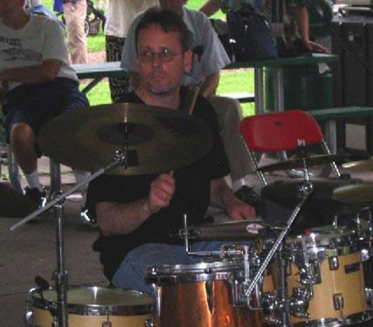 James Armstrong playing cymbals