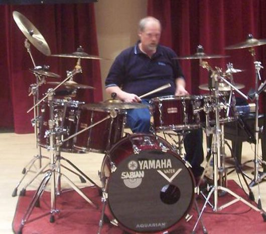 James B. Harrison playing cymbals