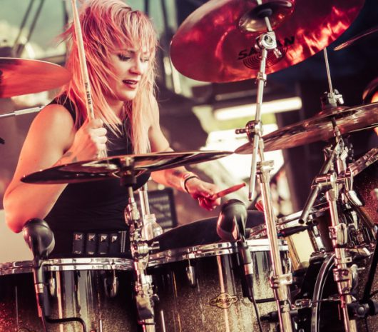Jen Ledger playing cymbals