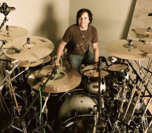 Jimmy DeGrasso playing cymbals