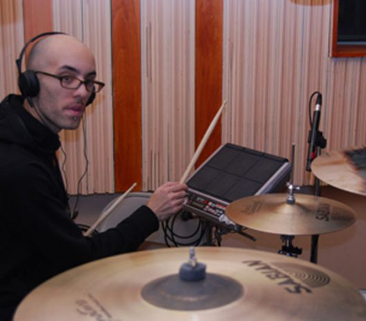 Joe Tomino playing cymbals