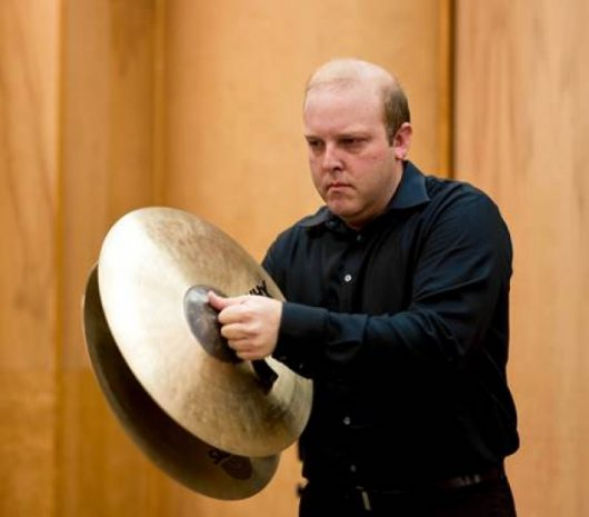 Joshua Bowman playing cymbals