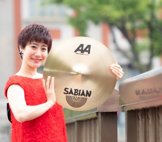 Kana Omori playing cymbals