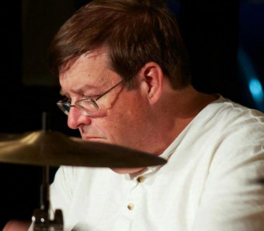 Keith Larson playing cymbals