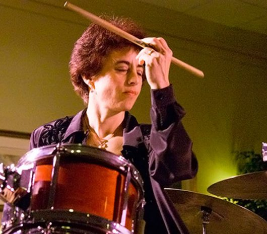 Kristen Shiner-McGuire playing cymbals