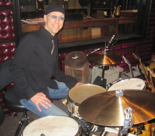 Larry Lelli playing cymbals