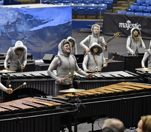 Legacy Performing Arts Percussion Ensemble playing cymbals