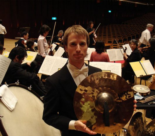 Ludvig Nilsson playing cymbals