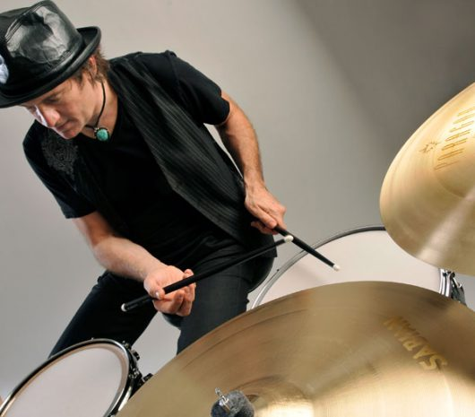 Mark Rogers playing cymbals