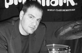 Matthew C. Cremisio playing cymbals