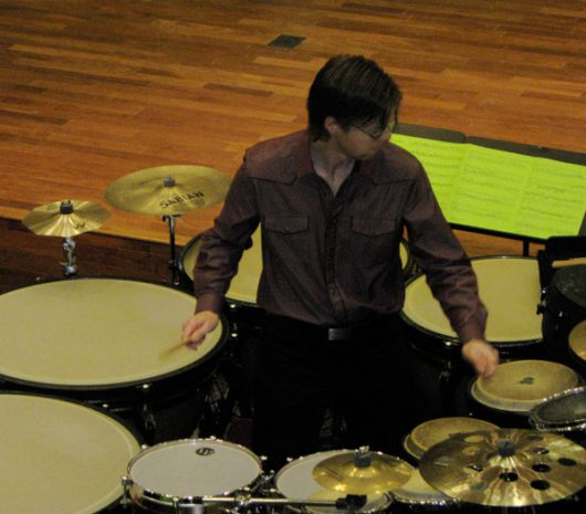 Matthew Coley playing cymbals