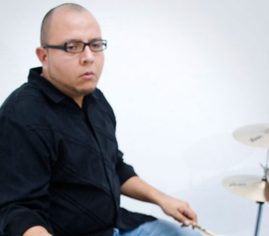 Miguel Hernandez playing cymbals