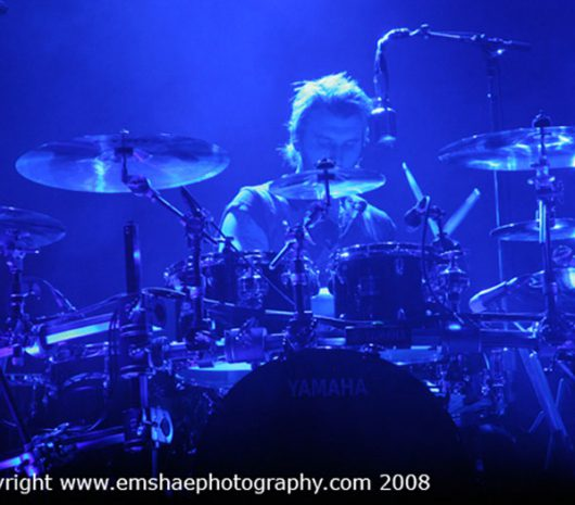 Neil Sanderson playing cymbals