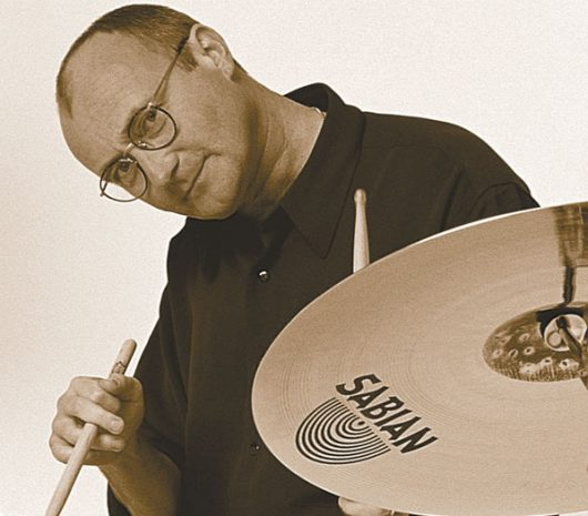 Phil Collins playing cymbals