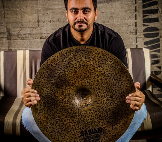 Rafael Bastos playing cymbals