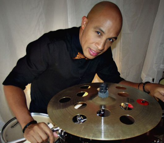 Robert Vilera playing cymbals