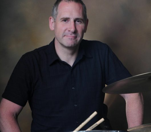 Russ Nyberg playing cymbals