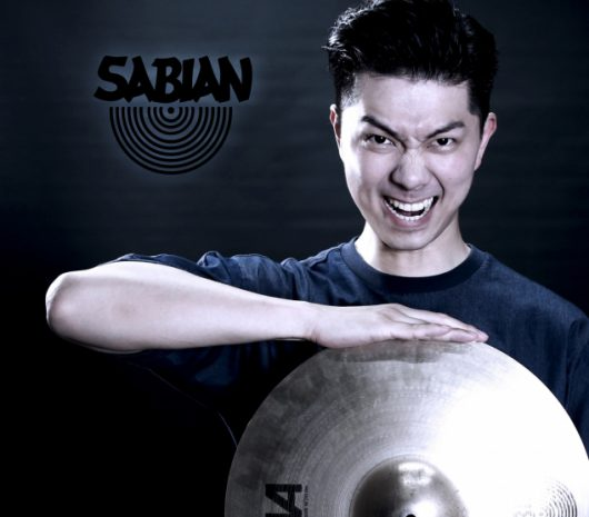 Samuel Wong playing cymbals