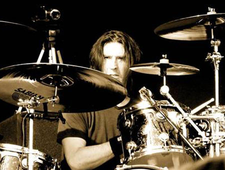 Sean Kinney playing cymbals