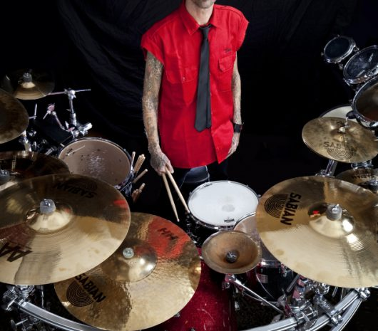 Shannon Larkin playing cymbals