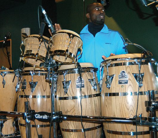 Sola Akingbola playing cymbals