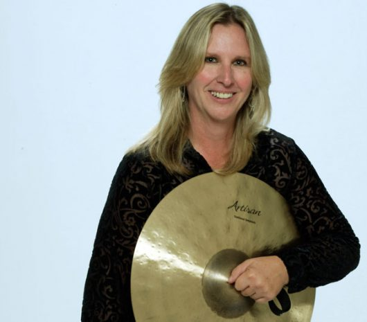Theresa Dimond playing cymbals