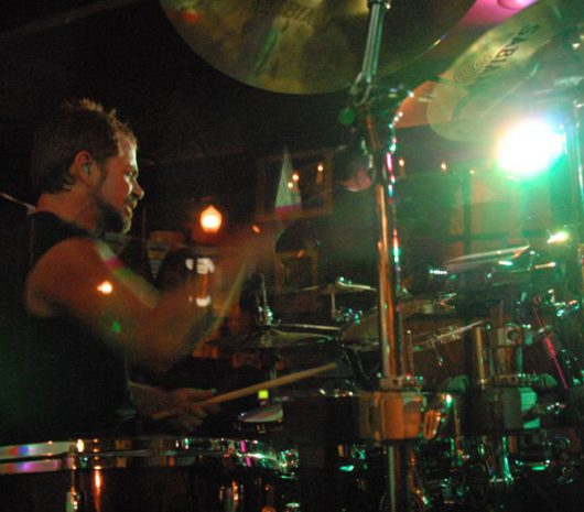 Tommy Sutherland playing cymbals